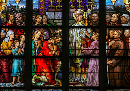 north brabant: S HERTOGENBOSCH, THE NETHERLANDS - JULY 23, 2011: Stained Glass Window depicting Saint Wilibrord baptising the Frank Aengilbert in Den Bosch Cathedral, North Brabant. Editorial