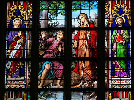 Luke: S HERTOGENBOSCH, THE NETHERLANDS - JULY 23, 2011: Stained Glass Window depicting the verse Luke 15:10 in Den Bosch Cathedral, North Brabant. There is rejoicing in the presence of the angels of God over one sinner who repents.