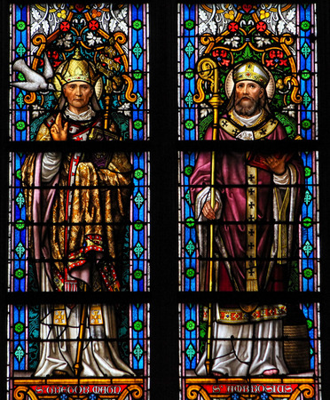 theologian: S HERTOGENBOSCH, THE NETHERLANDS - JULY 23, 2011: Stained Glass Window depicting Saint Gregorius and Saint Ambrosius in Den Bosch Cathedral, North Brabant. Editorial