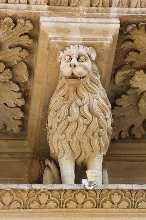 telamon: Lion statue at the Basilica of Santa Croce or Church of the Holy Cross is a famous baroque church in Lecce, a historic city in Apulia, Southern Italy. Stock Photo