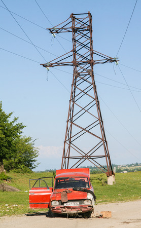 car wreck: AKHMETA, GEORGIA - JUNE 20, 2008: Car wreck and electricity pylon on a road near Akhmeta, Kakheti Region, in Georgia