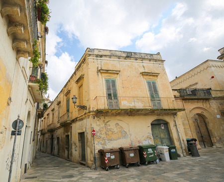 old center: LECCE, ITALY - MARCH 13, 2015: Old houses in the typical yellow Lecce stone in the old center of Lecce, a historic city in Apulia, Southern Italy Editorial