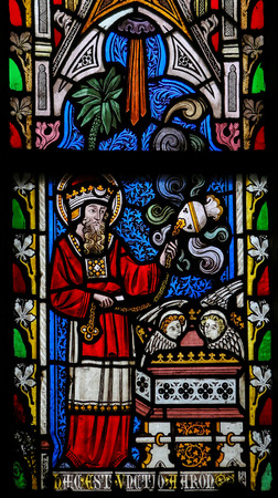 priesthood: ST TRUIDEN, BELGIUM - APRIL 21, 2013: Stained glass window in the church of Our Lady in Saint Truiden, Belgium. This window depicts Leviticus 7:35: This is the portion of the anointing of Aaron.