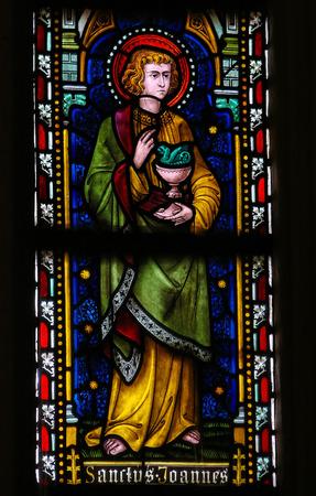 limburg: ST TRUIDEN, BELGIUM - APRIL 21, 2013: Stained glass window, depicting Saint John the Evangelist, in the Cathedral of Saint Truiden in Limburg, Belgium. Editorial