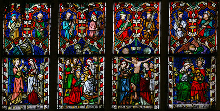 Mother Mary: Stained glass window depicting scenes in the life of Mother Mary, in the Cathedral of Sint-Truiden in Limburg, Belgium. Editorial