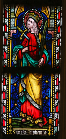 praised: Stained glass window depicting Saint Euphemia, a Christian saint who was martyred in 303 AD in Chalcedon, in the Cathedral of Saint Truiden in Limburg, Belgium.
