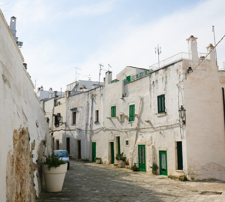 south italy: Typical white houses in the Old Town of the medieval city Ostuni in Puglia, South Italy. Editorial