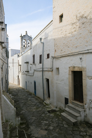 south italy: Narrow alley in the center of the medieval town Ostuni in Puglia, South Italy.