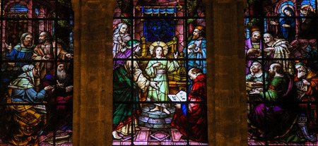 theologian: MALAGA, SPAIN - NOV 29, 2013: Stained glass window depicting the Child Jesus at the Temple, in the cathedral of Malaga, Spain.