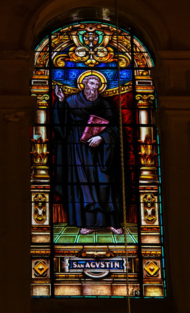 theologian: MALAGA, SPAIN - NOV 29, 2013: Stained glass window depicting Saint Augustine of Hippo, an important Christian theologian and philosopher, in the cathedral of Malaga, Spain. Editorial