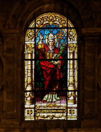 patron: MALAGA, SPAIN - NOV 29, 2013: Stained glass window depicting Pope Clement I, bishop of Rome from 92 to 99, martyr and patron saint of mariners, in the cathedral of Malaga, Spain.