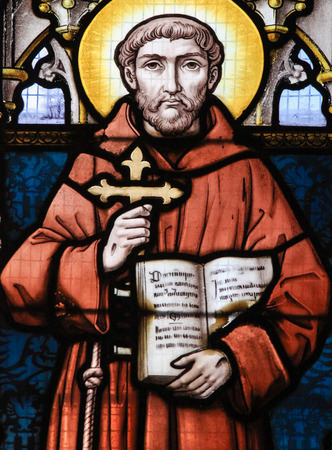 franciscan: STABROEK, BELGIUM - JUNE 27, 2015: Stained glass window depicting Saint Francis of Asisi in the Church of Stabroek, Belgium. Editorial