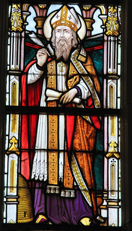 theology: STABROEK, BELGIUM - JUNE 27, 2015: Stained glass window depicting Saint Ambrose or Ambrosius, in the Church of Stabroek, Belgium. Editorial