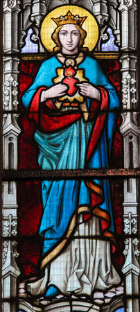 mother of jesus: STABROEK, BELGIUM - JUNE 27, 2015: Stained glass window depicting Mother Mary in the Church of Stabroek, Belgium.