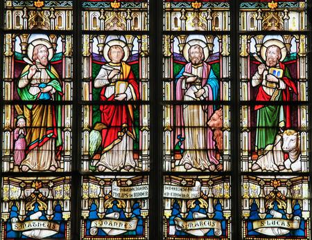 STABROEK, BELGIUM - JUNE 27, 2015: Stained glass window depicting the Four Evangelists, Saint Matthew, Saint John, Saint Mark and Saint Luke, in the Church of Stabroek, Belgium.