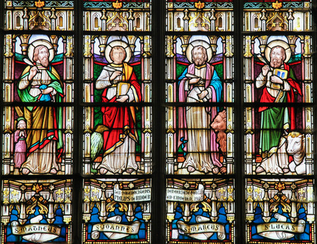 johannes: STABROEK, BELGIUM - JUNE 27, 2015: Stained glass window depicting the Four Evangelists, Saint Matthew, Saint John, Saint Mark and Saint Luke, in the Church of Stabroek, Belgium.