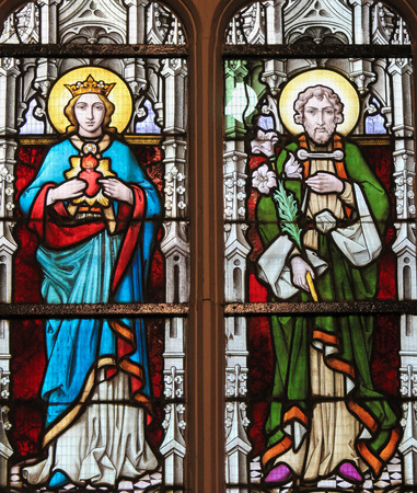 mother of jesus: STABROEK, BELGIUM - JUNE 27, 2015: Stained glass window depicting Mother Mary and Saint Joseph, parents of Jesus Christ, in the Church of Stabroek, Belgium.