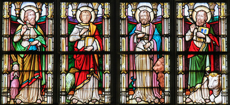 STABROEK, BELGIUM - JUNE 27, 2015: Stained glass window depicting the Four Evangelists, Saint Matthew, Saint John, Saint Mark and Saint Luke, in the Church of Stabroek, Belgium.