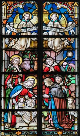 bible shepherd: STABROEK, BELGIUM - JUNE 27, 2015: Stained glass window depicting a Nativity Scene at Christmas in the Church of Stabroek, Belgium.