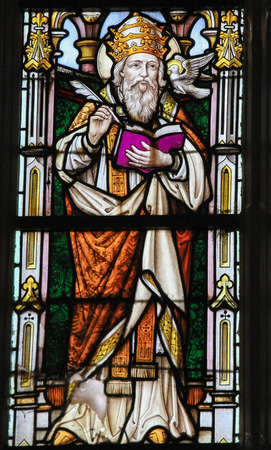 theologian: STABROEK, BELGIUM - JUNE 27, 2015: Stained glass window depicting Saint Gregory the Great or Pope Gregory I, pope from 590 to 604, in the Church of Stabroek, Belgium.