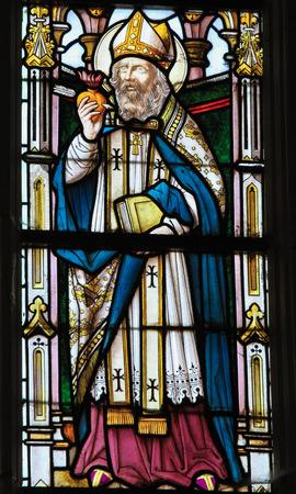 theology: STABROEK, BELGIUM - JUNE 27, 2015: Stained glass window depicting Saint Augustine in the Church of Stabroek, Belgium.