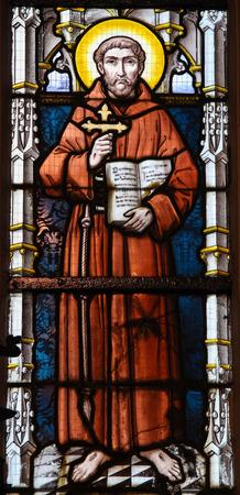 saint: STABROEK, BELGIUM - JUNE 27, 2015: Stained glass window depicting Saint Francis of Asisi in the Church of Stabroek, Belgium. Editorial