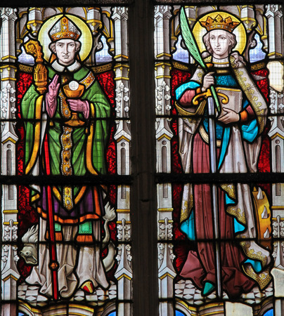 catholic stained glass: STABROEK, BELGIUM - JUNE 27, 2015: Stained glass window depicting two Catholic Saints, including Saint Catherine on the right, in the Church of Stabroek, Belgium.