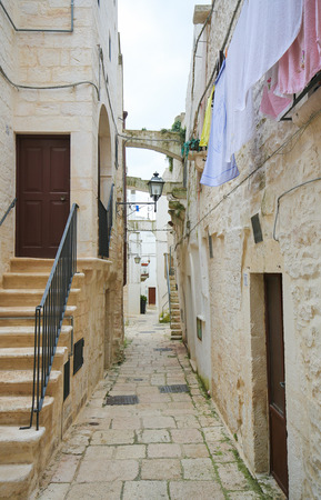 south italy: CISTERNINO, ITALY - MARCH 15, 2015: Narrow alley in the historic center of Cisternino in Puglia, South Italy