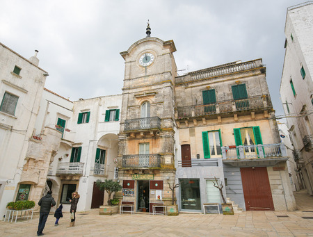 south italy: CISTERNINO, ITALY - MARCH 15, 2015: Torre dellorologio or clock tower in Cisternino,a comune in the province of Brindisi in Puglia, South Italy, known for its Salento wine Editorial