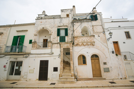 south italy: CISTERNINO, ITALY - MARCH 15, 2015: Historic houses in Cisternino, a comune in the province of Brindisi in Puglia, South Italy, known for its Salento wine