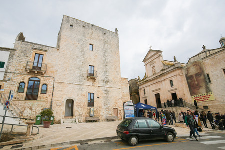 south italy: CISTERNINO, ITALY - MARCH 15, 2015: Torre civica (12th Century) in Cisternino, a comune in the province of Brindisi in Puglia, South Italy, known for its Salento wine