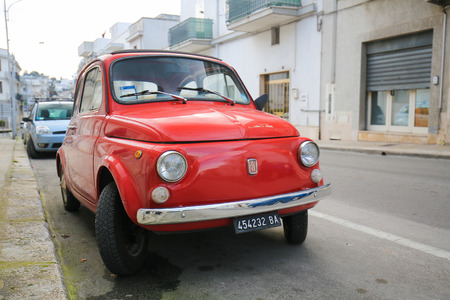old timer: ALBEROBELLO, ITALY - MARCH 15, 2015: The iconic Fiat 500 on a street in Alberobello, small town of the Metropolitan City of Bari, Puglia, Southern Italy.
