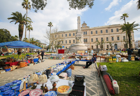 fleamarket: MARTINA FRANCA, ITALY - MARCH 15, 2015: Flea market at the Piazza Vittorio Veneto in the center of Martina Franca, Taranto province, South Italy. Editorial