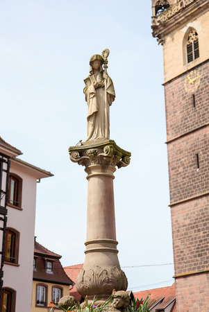 des vins: Statue of Saint Odile in Obernai, Bas-Rhin, Alsace, France Editorial