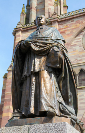 des vins: Statue of a bishop in Obernai, Alsace, France