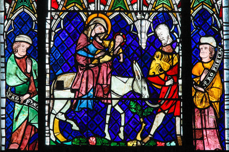 STRASBOURG, FRANCE - MAY 9, 2015: Stained glass depicting the Flight into Egypt in the cathedral of Strasbourg, France Stock Photo