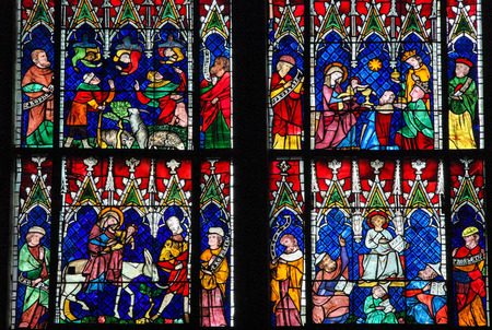 new ages: STRASBOURG, FRANCE - MAY 9, 2015: Stained glass depicting The Adoration of the Magi, the Flight into Egypt and Christ in the Temple of Jerusalem, in the cathedral of Strasbourg, France