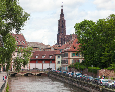collegial: STRASBOURG, FRANCE - MAY 9, 2015:  Famous sandstone Notre Dame Cathedral in Strasbourg, capital of the Alsace region in France. It was the worlds tallest building from 1647 to 1874.