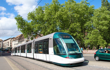 tramline: STRASBOURG, FRANCE - MAY 9, 2015:  Tram passing through a street in Strasbourg, capital of Alsace, France