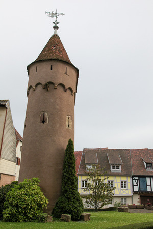 des vins: Medieval tower next to St. Peter and Paul church in Obernai, Alsace, France.