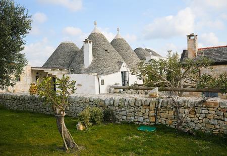 trulli: Typical Trulli in Alberobello, a small town of the Metropolitan City of Bari, Puglia, Southern Italy. Editorial