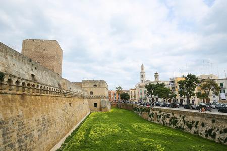 norman castle: BARI, ITALY - MARCH 16, 2015: View on the Swabian Castle or Castello Svevo and Bari Cathedral in Bari, Puglia, Italy.