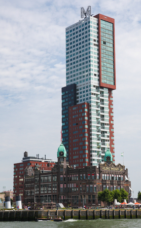 maas: ROTTERDAM, THE NETHERLANDS - AUGUST 9, 2015: Hotel New York, the former office building of the Holland America Lines in the Kop van Zuid neighborhood in Rotterdam, by the Nieuwe Maas in South Holland, The Netherlands.