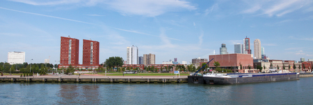 maas: ROTTERDAM, THE NETHERLANDS - AUGUST 9, 2015: View on the city center with the Erasmus hospital and residential blocks by the Nieuwe Maas in Rotterdam, South Holland, The Netherlands. Editorial
