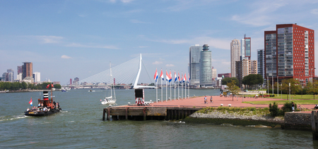 maas: ROTTERDAM, THE NETHERLANDS - AUGUST 9, 2015: View on the city center and the Kop van Zuid neighborhood in Rotterdam, by the Nieuwe Maas in South Holland, The Netherlands.