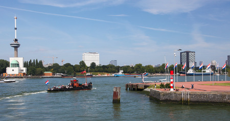 maas: ROTTERDAM, THE NETHERLANDS - AUGUST 9, 2015: View on the city center with the Euromast and Erasmus hospital by the Nieuwe Maas in Rotterdam, South Holland, The Netherlands.