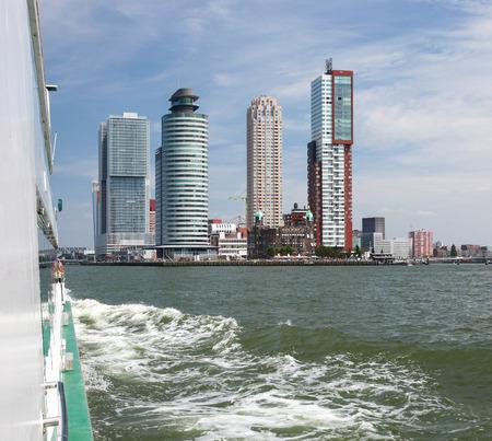 maas: ROTTERDAM, THE NETHERLANDS - AUGUST 9, 2015: Residential skyscrapers at Kop van Zuid neighborhood in Rotterdam, by the Nieuwe Maas in South Holland, The Netherlands.