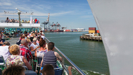 maas: ROTTERDAM, THE NETHERLANDS - AUGUST 9, 2015: Tourists on a cruise boat in the Port of Rotterdam, by the Nieuwe Maas in South Holland, The Netherlands.