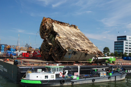 ship wreck: ROTTERDAM, THE NETHERLANDS - AUGUST 9, 2015: Ship wreck in the Port of Rotterdam, South Holland, The Netherlands. Rotterdam Port is the largest port in Europe. Editorial