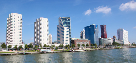 maas: ROTTERDAM, THE NETHERLANDS - AUGUST 9, 2015: View on skyscrapers by the Nieuwe Maas inthe center of Rotterdam, South Holland, The Netherlands.